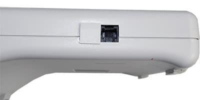 Левая стороны Орион-100Ф: порт RS-232 и заглушка